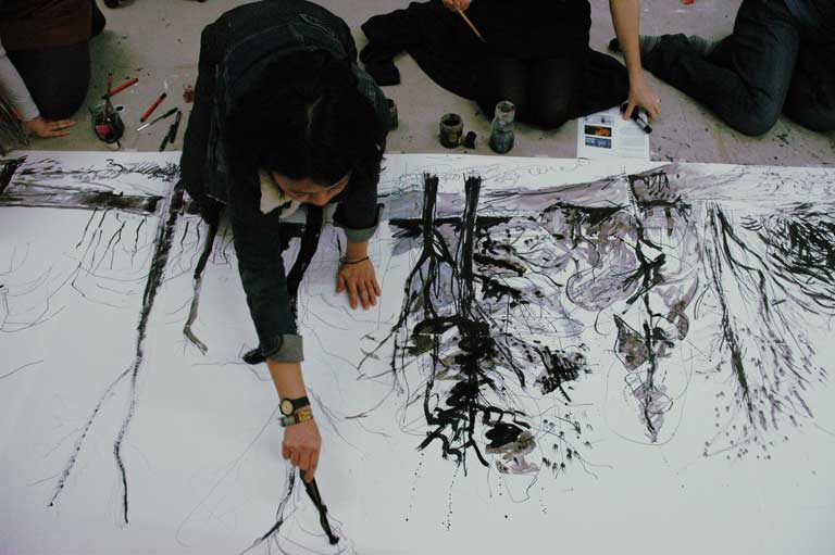 Students are working on the joint tree scape painting.