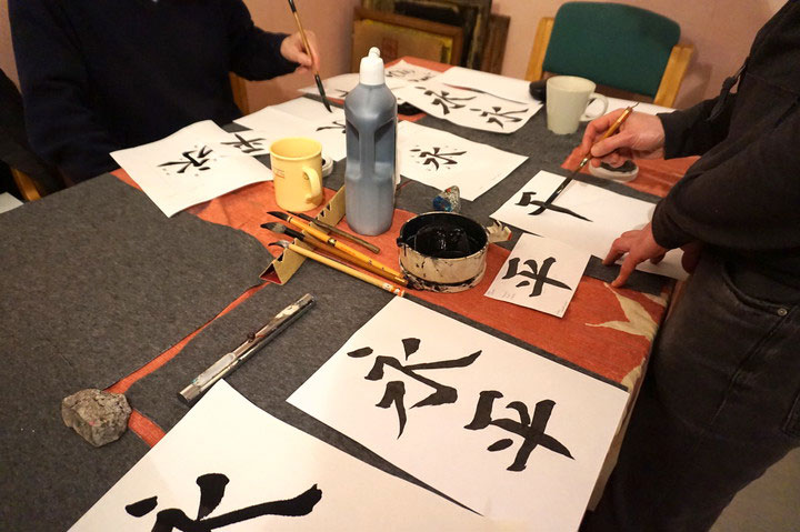 Working on calligraphy kanji 'Eihei' - eternal peace